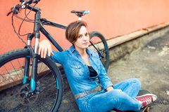 Portrait of young beautiful brunette woman wearing stylish hipster summer sportive outfit, urban lifestyle. Smiling and ha stock photography