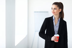 Portrait of young beautiful business woman with cup of coffee in stock photos