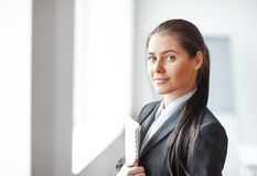 Portrait of young beautiful business woman with documents in the Stock Images