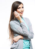 Portrait of young beautiful business woman on phon Royalty Free Stock Images