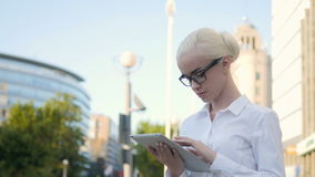 Portrait of Young Beautiful Business Woman Using Tablet PC Outdoors Stock Photography
