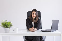 portrait of a young beautiful businesswoman working in the office and looking at the camera. Business concept. White background. royalty free stock image