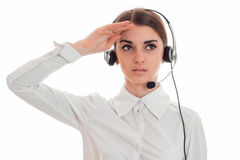 Portrait of young beautiful call office girl in white shirt with headphones isolated on  background in studio Stock Photography