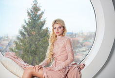 Portrait of young beautiful caucasian blond girl in gorgeous dre Royalty Free Stock Image
