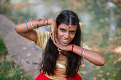 Portrait of a young beautiful cheerful traditional indian woman Stock Photo