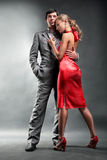 Portrait of a young beautiful couple. Young woman embraces man. Woman in a red dress Stock Photography