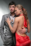 Portrait of a young beautiful couple. Young woman embraces man Stock Images