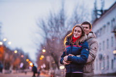 Portrait of young beautiful couple kissing in an autumn rainy day. Royalty Free Stock Photos