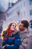 Portrait of young beautiful couple kissing in an autumn rainy day. Royalty Free Stock Image