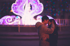 Portrait of young beautiful couple kissing in an autumn rainy day. Royalty Free Stock Images