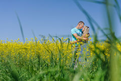 Portrait of young beautiful couple kissing. Stunning sensual young couple in love posing in summer field, happy lifestyle concept. Man and Woman in love together Royalty Free Stock Photography