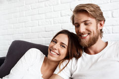 Portrait of young beautiful couple smiling looking at camera. Royalty Free Stock Photos