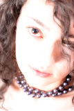 Portrait of a young beautiful curly woman Royalty Free Stock Photography