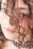 Portrait of a young beautiful curly woman Royalty Free Stock Image