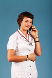 Portrait of a young beautiful doctor with phone Stock Image