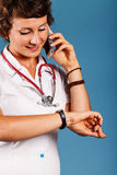 Portrait of a young beautiful doctor with phone Royalty Free Stock Photography