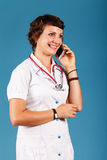 Portrait of a young beautiful doctor with phone Royalty Free Stock Images