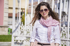 Portrait of young beautiful fashion woman with pink scarf outdoor Stock Photography