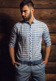 Portrait of young beautiful fashionable man against wooden wall. Royalty Free Stock Photos