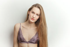 Portrait of young beautiful fashionable woman in purple bra Royalty Free Stock Photography