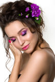 Portrait of young beautiful female holding touching her face. Bright spring or summer modern fashion make up. Pink lips and smokey eyes. Skin treatment or Royalty Free Stock Photo