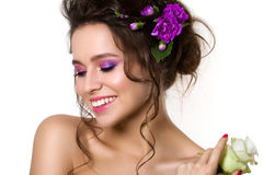 Portrait of young beautiful female holding white rose with viole Stock Image