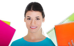 Portrait of a young beautiful female student holding workbooks. Royalty Free Stock Image
