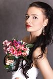 Portrait of a young beautiful fiancee with a bunch of pink flowe Stock Photography
