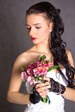 Portrait of a young beautiful fiancee with a bunch of pink flowe Royalty Free Stock Image