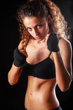 Portrait of young beautiful fitness woman, isolated on black background Royalty Free Stock Images