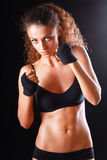 Portrait of young beautiful fitness woman, isolated on black background Stock Photos