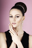 Portrait of young beautiful fresh slim girl with clean make-up and hair bun Stock Photography