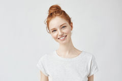 Portrait of young beautiful ginger woman with freckles cheerfuly smiling looking at camera. Isolated on white background Stock Photography
