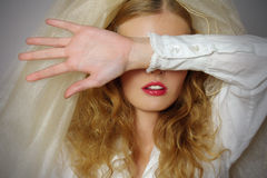 Portrait of young beautiful girl. Shuts the face with the hand Royalty Free Stock Photo