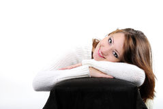 Portrait of the young beautiful girl. On a white background in a white sweater Royalty Free Stock Image