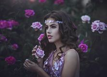 Portrait of a Young beautiful girl as a Princess in among the flowers . stock photos