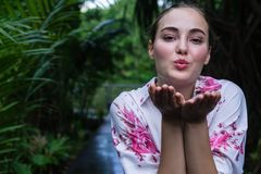 Portrait young beautiful girl blowing kiss.Model woman. stock photos