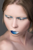 Portrait of young beautiful girl with blue lips Royalty Free Stock Images