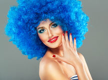 Portrait of a young beautiful girl with bright makeup in blue wi Stock Images