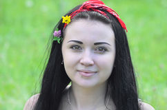 Portrait of a young, beautiful girl, brunette with flowers in her hair and scarf stock photography