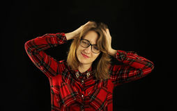Portrait of a young beautiful girl close-up in a red checkered shirt with various emotions on her face Stock Photo