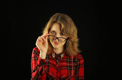 Portrait of a young beautiful girl close-up in a red checkered shirt with various emotions on her face Stock Image