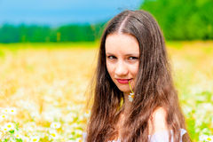 Portrait of a young beautiful girl with daisy flower. Portrait of  young beautiful girl with daisy flower Royalty Free Stock Images