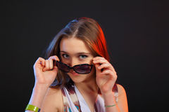 Portrait of the young beautiful girl on dark backg Royalty Free Stock Photography