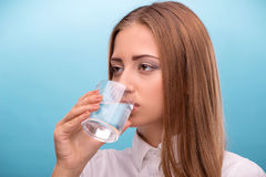 Portrait of young beautiful girl drinking clean Stock Photos