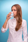 Portrait of young beautiful girl drinking clean Stock Photography