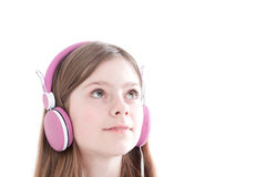Portrait of the young beautiful girl in earphones Royalty Free Stock Photography