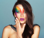 Portrait of a young beautiful girl with a fashion bright multicolored makeup royalty free stock images