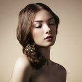 Portrait of young beautiful girl. Fashion photo Stock Photos