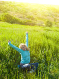 Portrait of young beautiful girl in a field at sunset. Royalty Free Stock Image